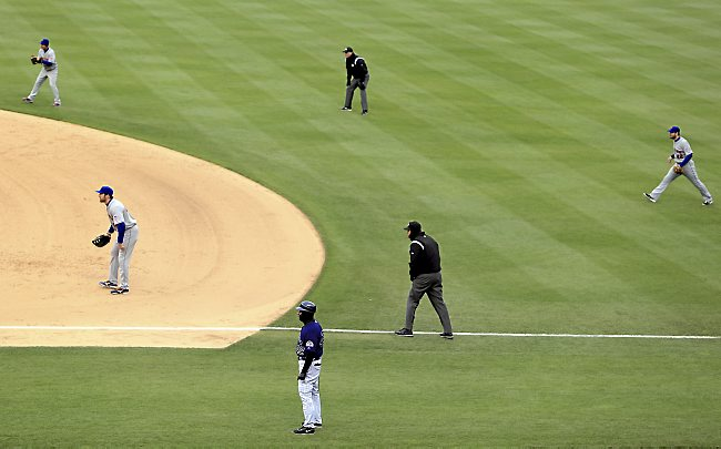 The New York Mets infield plays a defensive shift against Carlos Gonzalez of the Colorado Rockies at Coors Field on April 16, 2013 in Denver, Colorado. (Photo by Doug Pensinger/Getty Images)